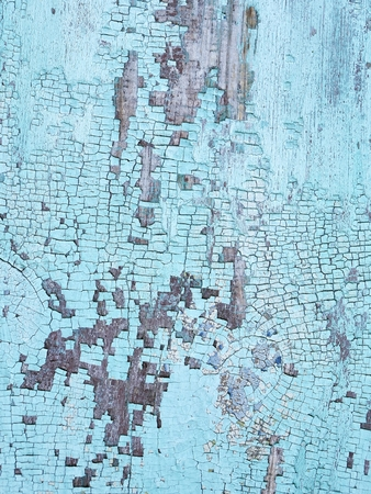 Texture of old wooden surface with crumbling blue paint Stock Photo