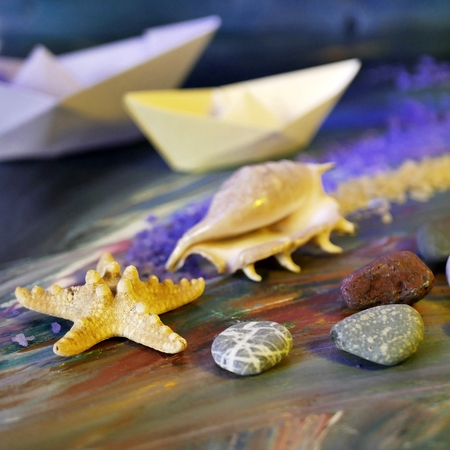 stones, sea salt, shells, starfish and paper boats