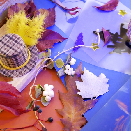 Halloween decor, autumn leaves, blue background, top view