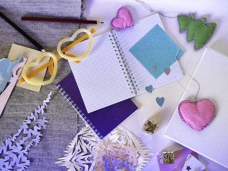 festive decor, white canvas, paper, pencils, notebook