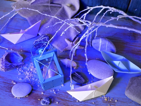 lanterns, blue textural background, sea stones