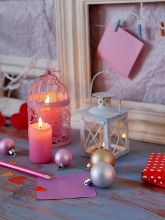 balls, lit candles, wooden frames, decorative lamps Stock Photo