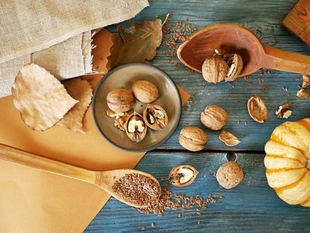 walnuts, flaxseed, wooden utensils, vintage, cooking healthy food Imagens