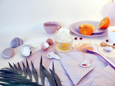 Sea salt, sliced orange, ingredients for a mask, scrub Imagens
