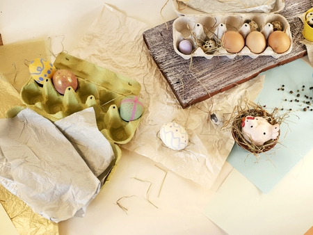 toy chicken, eggs, easter decor on a light background