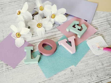 Mother's Day, congratulation, letters, decor, paper, pencils on the table, top view