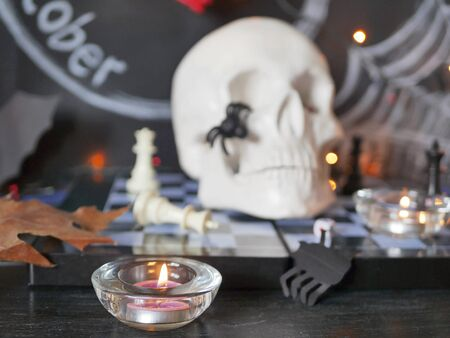 Halloween, skull, burning candles, decor, autumn leaves, illumination Stockfoto