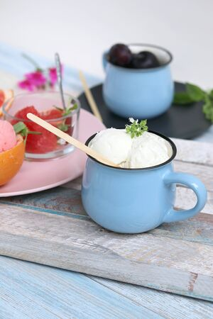 Natural ice cream, grapefruit, basil on a wooden table