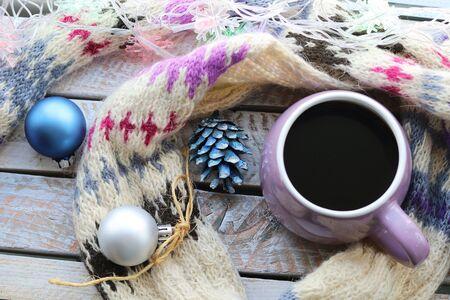 Cup of coffee, warm scarf, New Years decor, Christmas