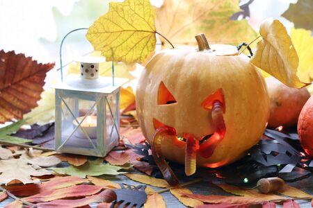 Halloween composition of jack-o-lantern, pumpkins, lamps, illuminations, mystical decor