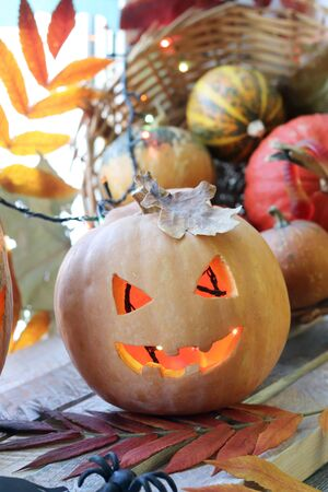 Halloween composition of jack-o-lantern, pumpkins, lamps, illuminations, mystical decor