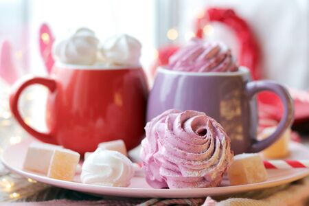 Two cups of coffee with meringues and marshmallows, Turkish delight Archivio Fotografico - 138047399