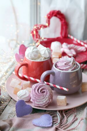 Two cups of coffee with meringues and marshmallows, Turkish delight Archivio Fotografico - 138047311