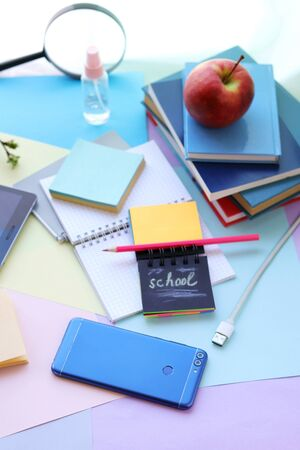 School stationery, tablet, phone on the desk, home schooling concept