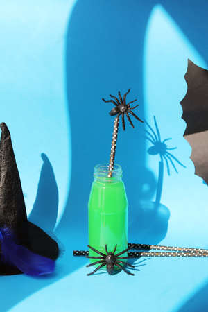 Happy Halloween, bottles with green cocktail, mystical decor, home interior for the holiday