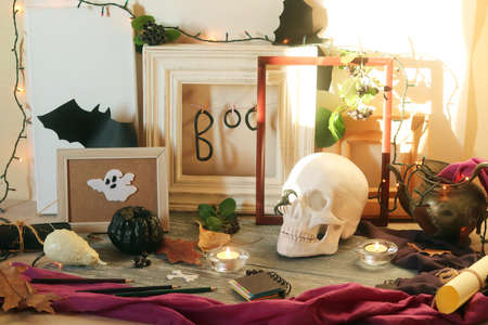 Happy Halloween, skull, mystical decor, frames, illumination and shadows, the concept of preparing a home interior for the holiday, October, autumn