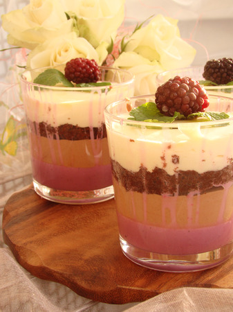 warren: Verrine with chocolate, creamy mousse, berry confit and almond biscuit and blackberries