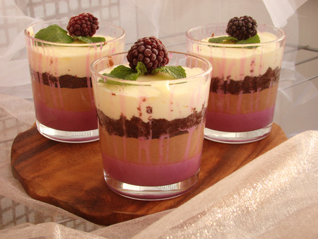 almond biscuit: Verrine with chocolate, creamy mousse, berry confit and almond biscuit and blackberries