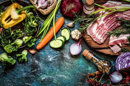 vegetable ingredients, spices and meat for cooking dishes in a rustic style