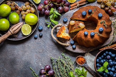 Cake baking with citrus and fresh blueberries, grapes and herbs, ingredients for cooking