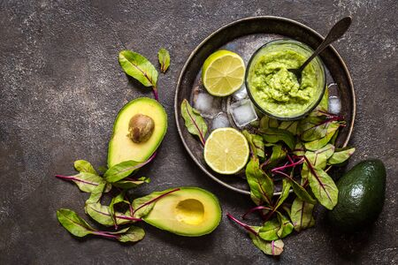 Smoothie of avocado and lime greens, healthy food, healthy lifestyle on a dark background
