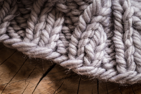 knitting gray wool, chunky knit with balls on wooden background 版權商用圖片