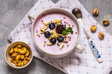 homemade yogurt with fresh blueberry and nuts, mint