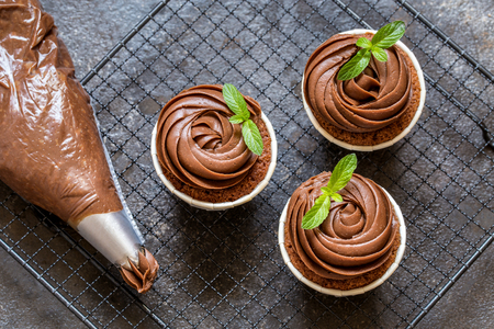 chocolate cupcake with chocolate cream in white capsules