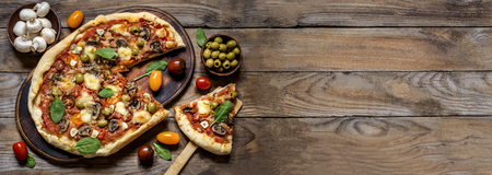 banner for advertisement pizza with mushrooms, tomatoes, olives and spinach on wooden background
