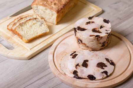 Homemade ham with prunes and homemade wheat bread with seeds Stock Photo