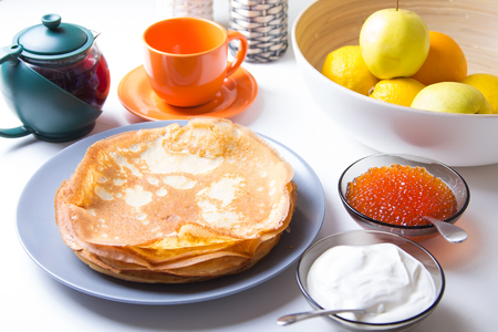maslenitsa: Traditional Russian pancakes with caviar and sour cream. Shrovetide. Selective focus