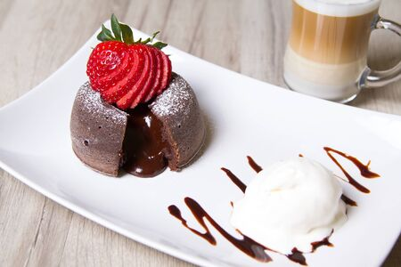 Chocolate fondant lava cake with strawberries and ice cream Stock Photo