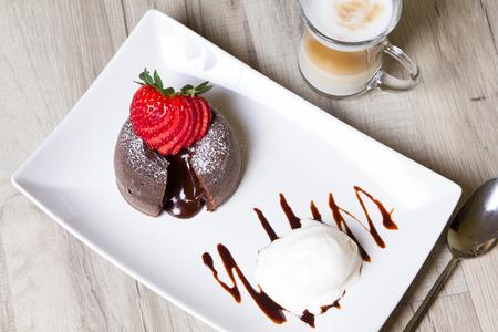Chocolate fondant lava cake with strawberries and ice cream Stock Photo