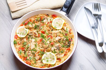 nourishing: Paella with chicken, tomatoes and pepper . Traditional Spanish dish. Selective focus