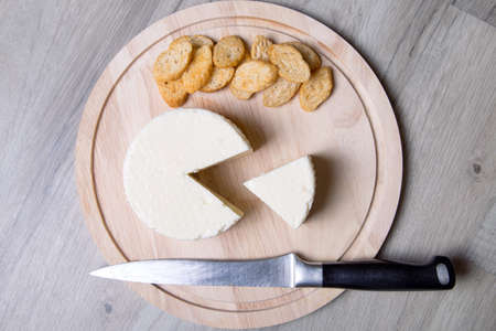 israeli: Tzfat cheese with crackers. Israeli traditional cheese. Symbol of the Jewish holiday Shavuot. Selective focus.