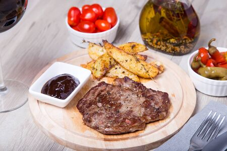 angus: Marble beef with potatoes, tomatoes and pepperoni. Selective focus. Stock Photo