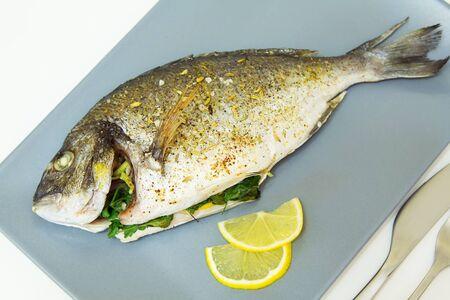 Baked fish dorado. Close-up, selective focus.