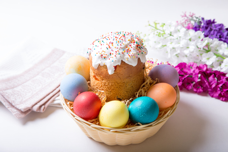 Easter. Traditional Russian and Ukrainian Easter cake (kulich) and painted eggs. Close-up, selective focus. Stock Photo