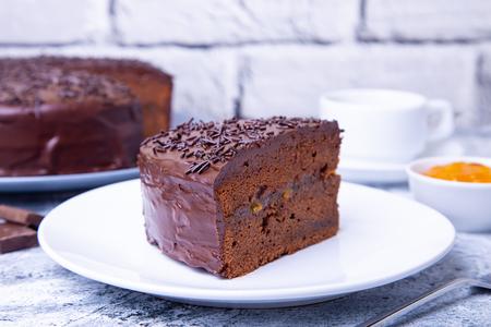 Sacher cake. Traditional Austrian chocolate dessert. Homemade baking. Selective focus, close-up.