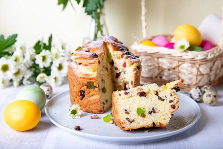 Craffin (Cruffin) with raisins and candied fruits. Easter Bread Kulich and painted eggs. Easter Holiday. Close-up.