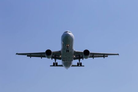 Passenger airplane in the sky close-up. Decrease in height. Greece, Corfu.