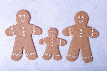 Gingerbread men and figures. Traditional New Year and Christmas homemade cookies. Christmas background. Selective focus, close up.