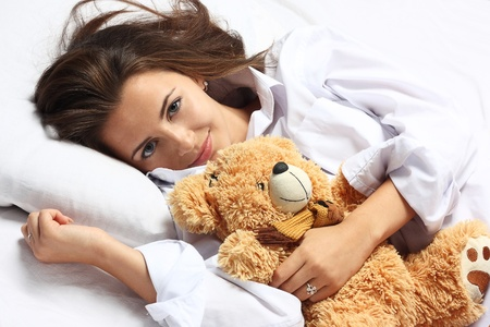 girl in bed with toy photo