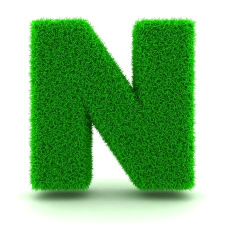 3D Lettera Erba verde su sfondo bianco photo