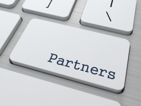 relate: Partnership Concept  Button on Modern Computer Keyboard with Word Partners on It