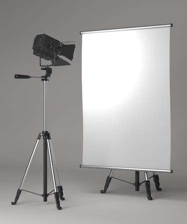 Flipchart on Tripod and Studio Lighting on Grey Background  photo