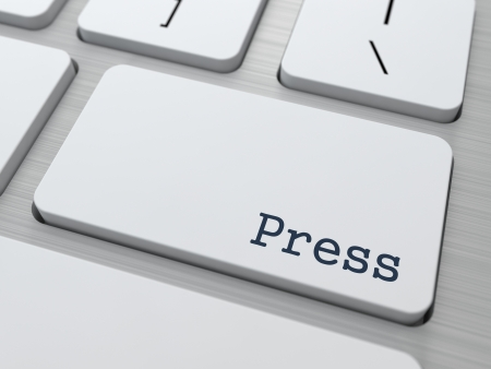 News Concept  Button on Modern Computer Keyboard with Word Press on It  photo