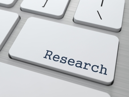 Research Concept  Button on Modern Computer Keyboard with Word Research on It  photo