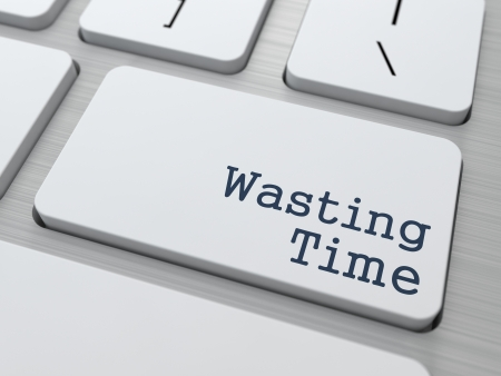 stress management: Wasting Time  Button on Modern Computer Keyboard with Word Partners on It