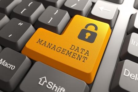 infomation: Infomation Management Concept  Orange Button on Computer Keyboard